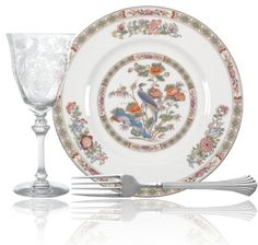 """Elegant tableware arrangement with """"Persian Pheasant"""" glass pattern from Tiffin / Franciscan, """"Birch Hall"""" silver pattern from Reed & Barton, and """"Kutani Crane"""" china pattern with gold trim, pastel flowers, & birds from Wedgwood. Dining Ware, Reed & Barton, Pastel Flowers, Dinner Sets, China Patterns, Wedgwood, Wines, Centerpieces, Decorative Plates"""