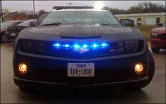 Chevrolet Camaro SS 2010 Police Car - built from a new Camaro SS, the Haltom City, Texas police department decided to enlist the help of a local custom shop built this menacing new patrol car. Haltom City Police commissioned Classic Chevrolet of Grapevine, Texas to build this one-of-a-kind Camaro SS police car complete with an LED bar on top, embedded bar in the rear window and a blue light strip embedded behind the muscle car's devious grin. Scary stuff!