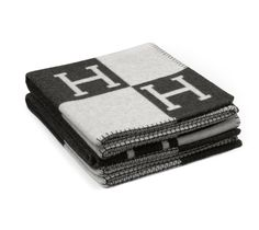 "Hermes Avalon  Signature H blanket in ecru/dark gray.  85% wool, 15% cashmere. Measures 55"" x 69""."