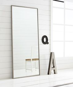 Hovet Mirror with big Aluminum letter at top of stairs