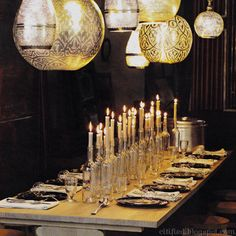 Beautiful #holiday #table - clusters of clear wine #bottles with taper #candles