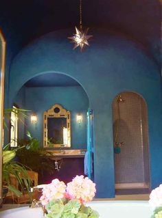 A large bathroom in the Moroccan style; lots of arches and a barrel vaulted