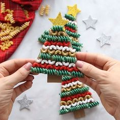Christmas Crafts kindergarten PASTA NOODLE CHRISTMAS TREE ORNAMENTS - Love how easy and fun these are to make! Kids will have fun painting and putting them together. Its a perfect Christmas craft for kids and adults too! Preschool Christmas, Christmas Activities, Preschool Winter, Easy Kids Christmas Crafts, Christmas Decorations Diy For Kids, Diy Ornaments For Kids, Christmas Crafts For Kindergarteners, Christmas Crafts To Sell Handmade Gifts, Homemade Christmas Crafts