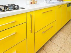 Brighten your mornings and add color and life to your kitchen design with yellow kitchen cabinets.