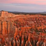 Bryce Canyon its really neat you hike down into it and its like a labyrinth of layered stone columns.