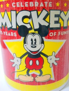 Amazon.com: Disney Coffee Mug Mickey Mouse Celebrate 75 Year of Fun! Yellow Star Old Look: Kitchen & Dining