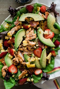 Summer Chipotle Chicken Cobb Salad. I love summer, but forget how these hot temps make me want to stay out of the kitchen. I'd rather grill outdoors. This recipe from the What's Gaby Cooking cookbook came to my rescue! This aint your average cobb salad. This one features summer ingredients like roasted corn, creamy avocado slices, juicy strawberries, crispy bacon, and smoky chipotle grilled chicken drizzled in a fresh, light and tangy lemon vinaigrette. Yum! #muybuenocookbook #salads