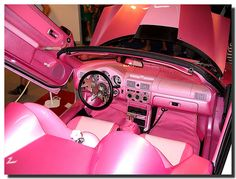I LOVE pink and the stars on the steering wheel, so me=)