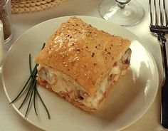 creamy onion pie with bacon, mushrooms and two cheeses