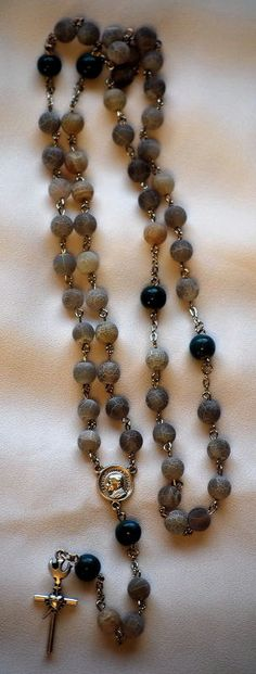 Dragons Vein Rosary by AllToolsPrayerful on Etsy   This Rosary is made from Grey Dragons Vein Agate 8mm beads for the Hail Mary, and round 9mm Teal Green beads for the Our Father beads. The Crucifix is The Sacred Heart of Jesus and Holy Spirit, and the Centerpiece is Pope (Saint) John Paul. Measures 21 1/2 inches.