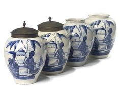 A SET OF FOUR DUTCH DELFT BLUE AND WHITE TOBACCO JARS  CIRCA 1750-1775, UNDERGLAZE BLUE B:P FOR DE VERGULDE BLOMPOT  Each ovoid body painted with a calumet-smoking Indian under a tobacco plant, beside a large vase named for RAPPE, MACUBA, VIOLET and POMPADOER, beside bales of tobacco inscribed V.O.C. to the left, two galleons in the distance, two with metal covers.
