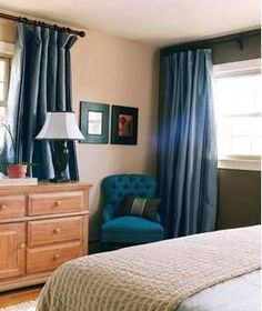 Blue chair in the corner of a bedroom