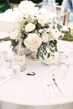 White wedding centrepiece - natural table arrangement - roses, hydrangea and eucalytpus - Floral Design: Floral Reactions Of Cape Cod - http://www.stylemepretty.com/portfolio/floral-reactions-of-cape-cod Hotel: Provincetown Inn - http://www.stylemepretty.com/portfolio/provincetown-inn Photography: null - null   Read More on SMP: http://www.stylemepretty.com/2016/04/20/an-interior-designers-cape-cod-wedding-with-to-die-for-nautical-details/