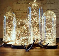 #DIY lighting #idea using bell jars of varying sizes and #string lights. How cool is this?