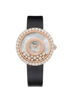 CHOPARD -  HAPPY DREAMS 36 MM 18K ROSE GOLD AND DIAMONDS $44,880 .  This stunning timepiece was created to mark the 40th anniversary of the Happy Diamonds collection, originally inspired by the myriad sparkling droplets of a waterfall. The 36 mm, 18k rose Gold case, Diamond-set bezel, satin strap, cloud-like white Mother-Of-Pearl dial and dancing prong-set diamonds all combine to evoke a soft, otherworldly landscape where dreams shift, shimmer and swirl in the light.