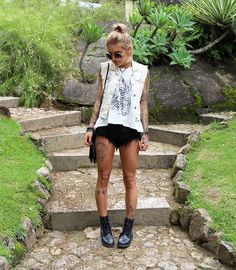 Get this look: http://lb.nu/look/7933938  More looks by Soraya Marx: http://lb.nu/sorayamarx  Items in this look:  Ui!Gafas Rounded Sunglasses, Diy Double Necklace, Cn Direct Hamsa Print T Shirt, C&A Ripped Shorts, Fyi Black Boots   #bohemian #edgy #street #sorayamarx #misturebachic #blogmisturebachic #fashionblogger #brazil #carioca