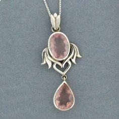 http://purpleleopardboutique.com/1265-2607-thickbox/rose-quartz-pendant-sterling-silver-w-wings-and-heart-.jpg  Rose Quartz sterling silver pendant #valentinesday #purpleleopardboutique #sterlingsilver