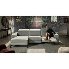 This open base electric recliner with headrest function features linear arms and black metal legs; key assets of any contemporary statement piece of the living room. Available in a large range of fabrics and colours: Sunday; and Graceland. Outdoor Furniture Sets, Outdoor Decor, Graceland, Couches, Black Metal, Recliner, Lounge, Colours, Contemporary