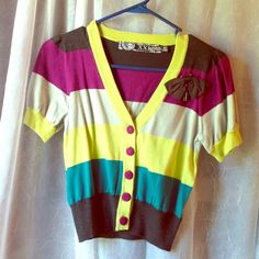 ⭐Forever 21 Twist short sleeve sweater⭐ NEVER WORN. Size Small! Forever 21 Twist Line, inspired by Alice and Wonderland. Striped with magenta, teal, charcoal, and a neon yellow-green, this short sleeve sweater has a removable pinned bow and charm accessory. This sweater is meant to be paired with the never worn Twisted dress from forever 21 and can also be purchased as a bundle for a lower price! Forever 21 Sweaters