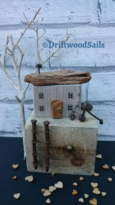Check out this item in my Etsy shop https://www.etsy.com/uk/listing/481820826/handcrafted-salvaged-wood-house-rustic