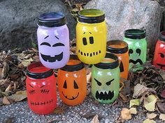 I'm not a big Halloween decorator but these are cute. Halloween Painted Jar Luminaries - Crafts by Amanda