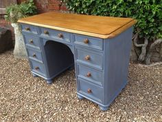 Beautiful desk painted in a soft mid blue with a waxed top, bun feet and wooden knobs