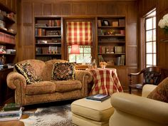 Nothing is cozier than a comfortable spot to read during cold winter months. HGTV fanBelleInteriors incorporated a red plaid window treatment and tablecloth with rich mahogany wood bookshelves for a comforting effect. A plush loveseat, ottoman and cowhide rug bring softness to the space.