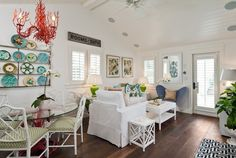 Tropical Living Room with French doors, Casement, Hardwood floors, Exposed beam, Ceiling fan, Standard height