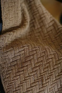 Ravelry: Kinetic scarf pattern by Norah Gaughan.  Nice stitch, would make a great afghan.