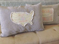 Ticking pillow with grain sack patch