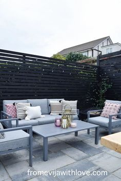 Garden Patio Area makeover, custom built black wooden privacy screen, grey slabbed area. Outdoor Privacy Screens, Garden Slabs, Large Planters, Amazing Spaces, Diy Patio, Modern Spaces, Dining Table Chairs, Outdoor Cushions, Decking