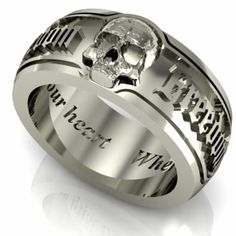 Silver Skull Wedding Ring for a Man - http://www.weddingringpictures.info/2015/08/17/silver-skull-wedding-ring-for-a-man/