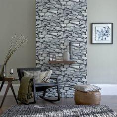 Mur en pierre naturelle dans le salon - le charme de la vraie pierre