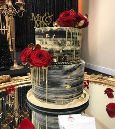 "Heyyy!! Today's cake was a cake that I completely fell in love with, the colours of the black, red and gold contrast was sooooo stunning! And it matched the stage of walima perfectly! A huge 7"" tall base of 10"" cake with a 8"" on top! Adorned with absolutely beautiful red roses from the lovely @mafleurr Finished off with some edible gold leaf! ❤️❤️❤️ #cake#congratulations#celebrate#weddingcakes#asianweddingcakes#asianbusinesspromoters#celebrationscakes#cake#cakedecorator#cakey#boltoncakes#man"