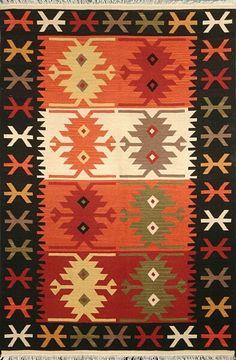 Great kilim rug in fall colors.