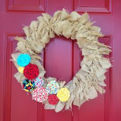 I made a new wreath for my front door.  1-3/4 yds burlap, straw wreath and scrappy flowers.