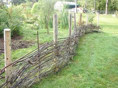 Stick fence - by the garage?  such a good idea....