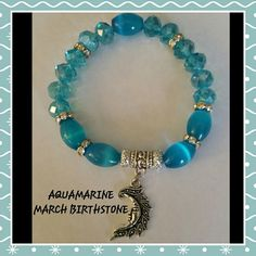 MARCH AQUAMARINE BRACELET A gorgeous Aquamarine semi precious oval beads with light blue crystal beads that have crystal spacers and a silver alloy dangle charm. Jewelry Bracelets