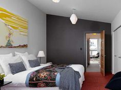 black wall paint and yellow wall decoration -  it is a myth that white creates space