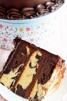 A classic vanilla and chocolate marble cake is stacked and frosted in a silky…