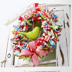 I don't need another wreath but this is so cute!  Fabric wreath with bird.