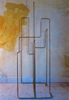 Brass coat stand - possibly a Tom Dixon design
