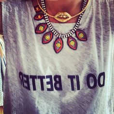 Multi cool necklaces over vintage style t-shirt