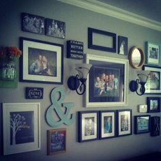 Love the ampersand and sconces in this family focused gallery wall.