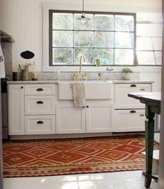 farm sink | rug in the kitchen
