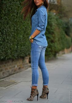 Denim shirt and jeans with leopard heels and gold accessories