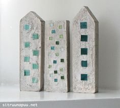 cement towers with tile inserts, great idea for garden decor. made from milk cartons and boxes.