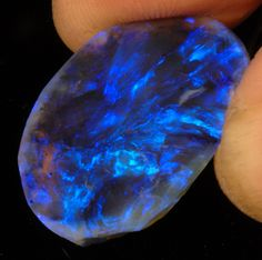Hand-held Lightning Ridge Black Opal | Very expensive. That … | Flickr - Photo Sharing!