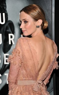 Emily Blunt, in beautiful backless dress.