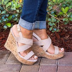 """Theses fantastic sandals features sophisticated crisscross straps in faux suede for a fashion-forward look with all-day comfort. 2"""" Platform - 4.5"""" Faux cork heel"""